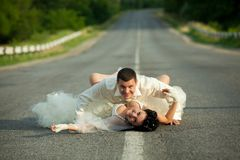Bride and groom on countryside road Stock Photo