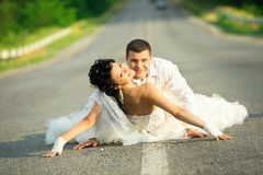 Bride and groom on countryside road Stock Image