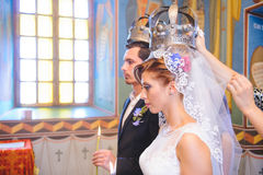 Bride and Groom in Crowns Stock Image