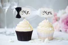 Bride and groom cupcakes stock photos