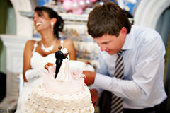 Bride and groom cut the wedding cake. In restourant Stock Images