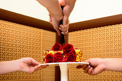The bride and groom cut the wedding cake.  Royalty Free Stock Images