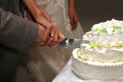 Bride and groom cut the wedding cake closeup Stock Photo