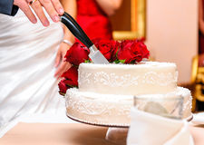 Bride and groom cutting wedding cake Stock Photography