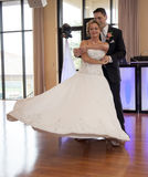 Bride and Groom dance. A happy bride and groom dancing during reception Royalty Free Stock Photography