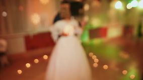 The bride and groom dance a slow dance among the burning candles in the shape of the heart. stock video footage