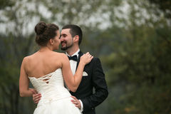 Bride and groom dance together in the woods Royalty Free Stock Image