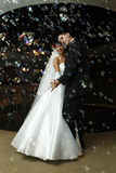 Bride and groom dancing. In the restaurant stock photography