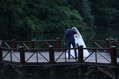Bride and groom dancing on the bridge Stock Image