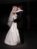 Bride and groom dancing in the dark. Profile Stock Images