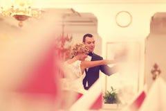 Bride and groom dancing in empty restaurant Stock Images