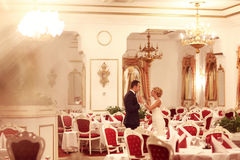 Bride and groom dancing in empty restaurant Royalty Free Stock Photos