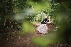 Bride and groom dancing in the forest background and sunlight stock photo
