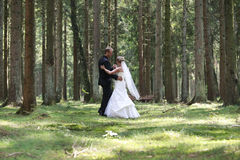 Bride and groom dancing in the forest Royalty Free Stock Photo