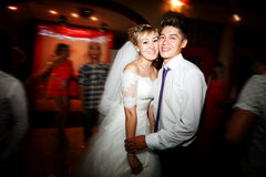 Bride and groom dancing motion on dance floor during wedding reception in  restaurant. Stock Photos