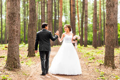 Bride and groom dancing  in nature. Wedding dance outdoors Royalty Free Stock Photo