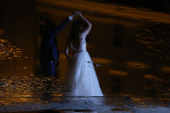 Bride and groom dancing in the night Stock Image