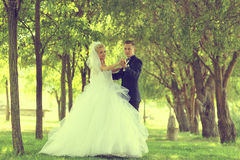 Bride and groom dancing outdoor Royalty Free Stock Photos