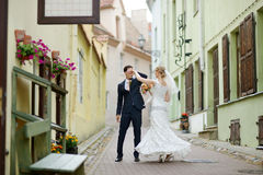 Bride and groom dancing outdoors Royalty Free Stock Photo