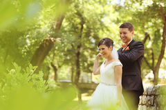 Bride and groom dancing in the park Royalty Free Stock Image