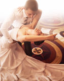Bride and groom dancing on parquet stock images