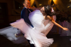Bride and groom dancing Stock Image