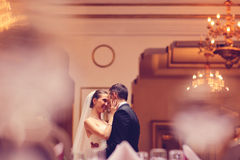 Bride and groom dancing in a restaurant Royalty Free Stock Photography
