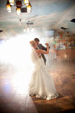 Bride and groom dancing in smoke Royalty Free Stock Images