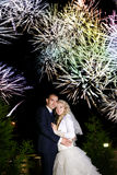 Bride and groom dancing sorrounding by fireworks Stock Images