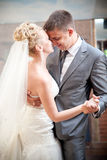 Bride and groom dancing waltz Stock Photos