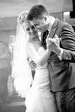 Bride and groom dancing waltz during wedding Stock Image