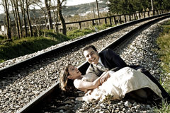 Bride and groom dating in railways. Grooms couple happy and smiling on a railway Stock Photography