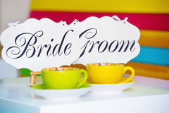 Bride and groom decoration boards and coffee cups Stock Photo