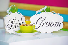 Bride and groom decoration boards and cup of coffee Royalty Free Stock Photo