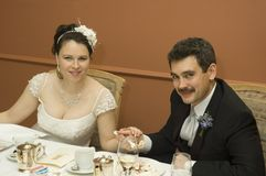 Bride and groom at dinner Stock Photography