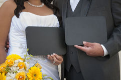 Bride and Groom Displaying your custom chalkboard message Royalty Free Stock Photography