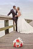 Bride and groom on dock Stock Image
