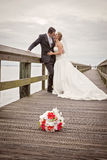 Bride and groom on dock Royalty Free Stock Photography