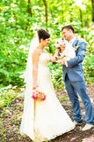 Bride and groom with  dog west highland white Royalty Free Stock Image
