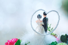 Bride and groom doll on bouquet in wedding ceremony Royalty Free Stock Photos