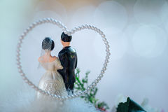 Bride and groom doll on bouquet in wedding ceremony. Royalty Free Stock Photography