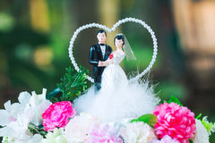 Bride and groom doll on bouquet in wedding ceremony Royalty Free Stock Images