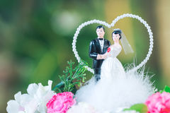 Bride and groom doll on bouquet in wedding ceremony Royalty Free Stock Photography