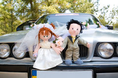 Bride and groom dolls on wedding car. Bride and groom dolls at front of wedding car Stock Photography