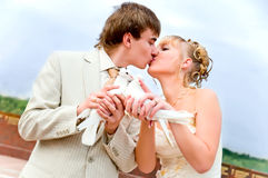 Bride and groom with doves Stock Images