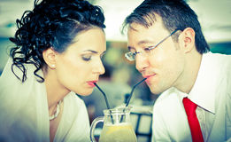 bride and groom  drink from the same glass Royalty Free Stock Photo