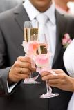 Bride and groom drinking champagne Stock Photography