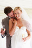 Bride And Groom Drinking Champagne At Wedding. Smiling To Camera Royalty Free Stock Photography