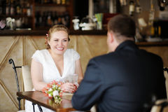 Bride and groom drinking coffee Stock Photography