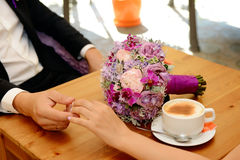 Bride and groom drinking coffee in a restaurant Royalty Free Stock Photo
